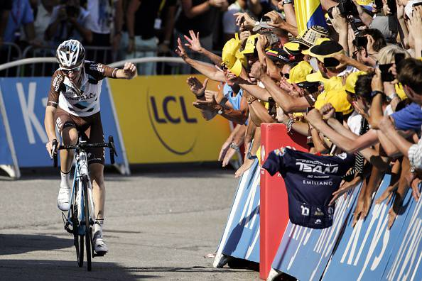 France's Romain Bardet rides past supporters ahead of the finish line at the end of the 186,5 km eighteenth stage of the 102nd edition of the Tour de France cycling race on July 23, 2015, between Gap and Saint-Jean-de-Maurienne, French Alps.   AFP PHOTO / KENZO TRIBOUILLARD        (Photo credit should read KENZO TRIBOUILLARD/AFP/Getty Images)