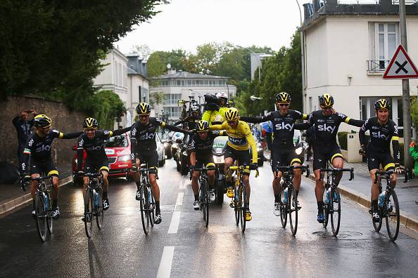 PARIS, FRANCE - JULY 26:  Chris Froome (yellow) of Great Britain and Team Sky celebrates his overall victory with team mates during the twenty first stage of the 2015 Tour de France, a 109.5 km stage between Sevres and Paris Champs-Elysees, on July 26, 2015 in Paris, France.  (Photo by Bryn Lennon/Getty Images)