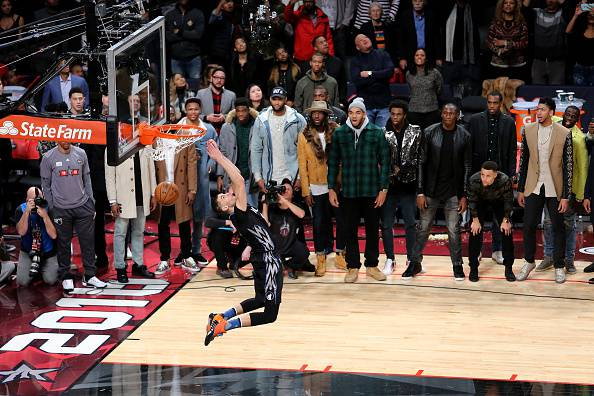 TORONTO, ON - FEBRUARY 13:  Zach LaVine of the Minnesota Timberwolves dunks as NBA players look on in the Verizon Slam Dunk Contest during NBA All-Star Weekend 2016 at Air Canada Centre on February 13, 2016 in Toronto, Canada. NOTE TO USER: User expressly acknowledges and agrees that, by downloading and/or using this Photograph, user is consenting to the terms and conditions of the Getty Images License Agreement.  (Photo by Vaughn Ridley/Getty Images)