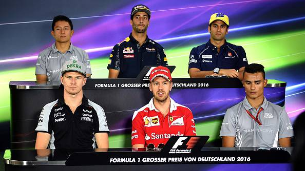 (back L-R) Manor F1 Team's Indonesian driver Rio Haryanto, Red Bull Racing's Australian driver Daniel Ricciardo, Sauber F1 Team's Brazilian driver Felipe Nasr, (down L-R) Sahara Force India German driver Nico Hulkenberg, Ferrari's German driver Sebastian Vettel, Manor F1 Team's German driver Pascal Wehrlein attend a press conference ahead of the Formula One German Grand Prix at the Hockenheim  circuit on July 28, 2016. / AFP / PATRIK STOLLARZ        (Photo credit should read PATRIK STOLLARZ/AFP/Getty Images)