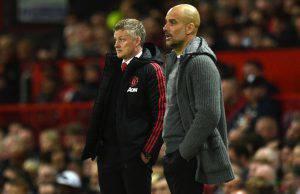 Solskjaer e Guardiola durante il derby