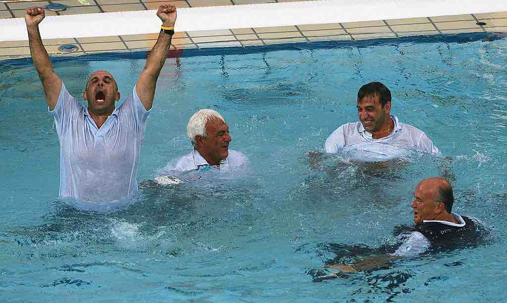 ATHENS - AUGUST 26: The Italian coaching staff celebrate after their extra-time win in the women's Water Polo gold medal game against Greece on August 26, 2004 during the Athens 2004 Summer Olympic